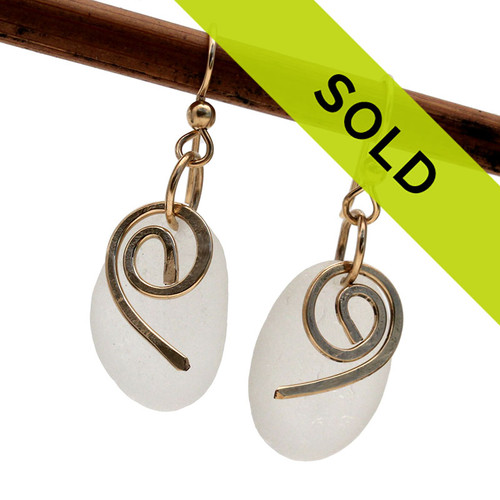 Beautiful thick large pieces of natural white sea glass are combined with hand hammered Hurricane details in this pair of sea glass earrings. This is the EXACT pair you will receive!