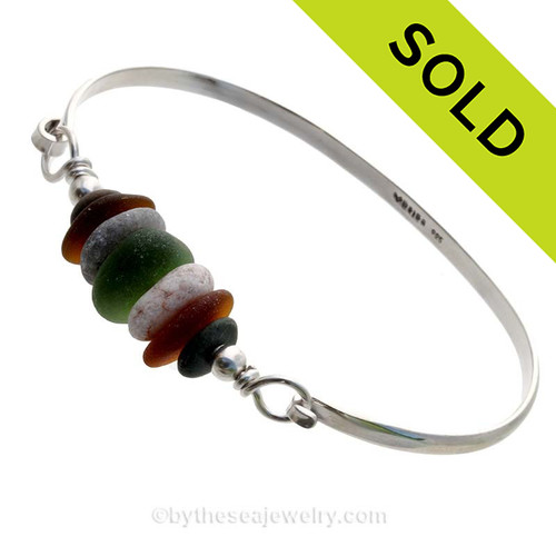 Fall Colors of Olive Green and Amber Brown and a beach found stones from Greece on this Solid Sterling  Half Round Bangle Bracelet.