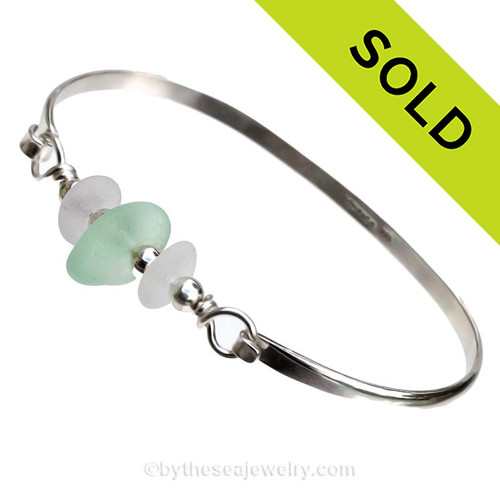 Two Pure White Sea Glass pieces and a Seafoam Green Sea Glass on this Solid Sterling  Half Round Bangle Bracelet.