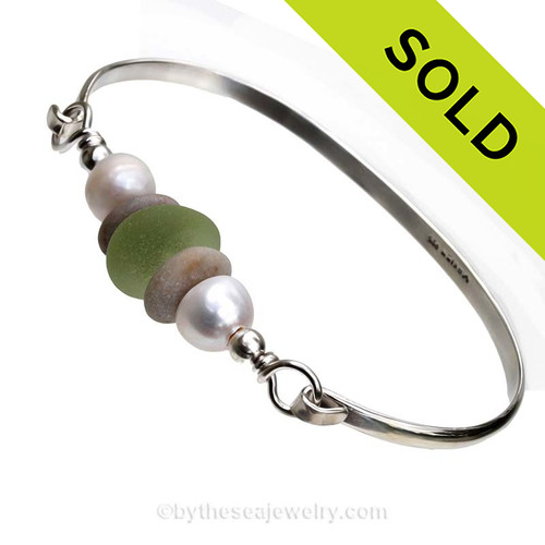 Lovely Light Peridot Green Sea Glass and a beach found gray stones from Greece on this Solid Sterling  Half Round Bangle Bracelet. Large Fresh Water Pearls for a bit of elegance. SOLD - Sorry this Sea Glass Bangle Bracelet is NO LONGER AVAILABLE!