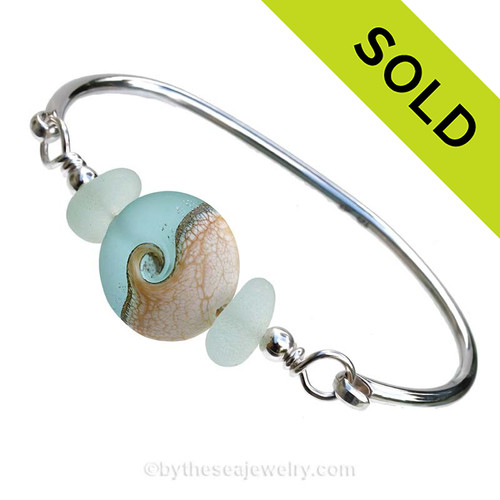 Genuine Seaofam Green Sea Glass Bangle Bracelet set with a handmade lamp work glass wave bead in soft aqua with sterling end beads on a solid sterling full round premium bangle bracelet. SOLD - Sorry this Sea Glass Bangle Bracelet is NO LONGER AVAILABLE!