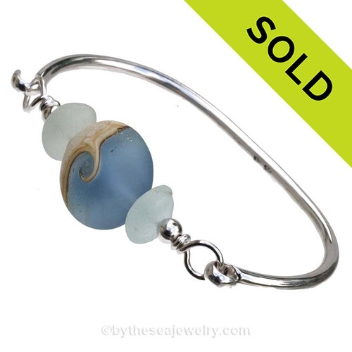Genuine Seafoam Green Sea Glass Bangle Bracelet set with a handmade lamp work glass wave bead in blue with sterling end beads on a solid sterling full round premium bangle bracelet. SOLD - Sorry this Sea Glass Bangle Bracelet is NO LONGER AVAILABLE!