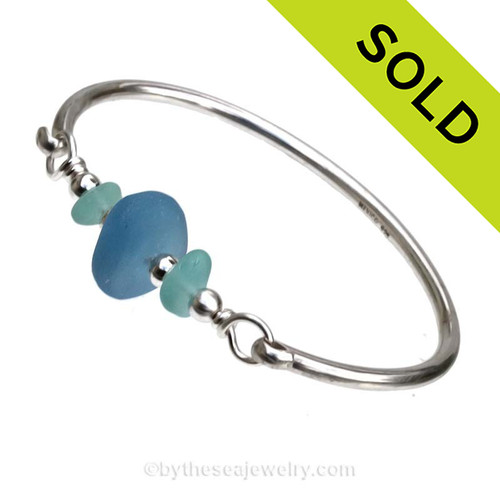 Vivid Aqua Blue Sea Glass pieces and a large Recycle Glass bead in bright Blue on this Solid Sterling Silver Full Round Sea Glass Bangle Bracelet. SOLD - Sorry this Sea Glass Bangle Bracelet is NO LONGER AVAILABLE!