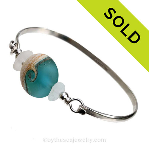 Pure White Genuine Sea Glass Bangle Bracelet set with a handmade Vivid Aqua lampwork glass wave bead set with sterling details on a solid sterling round bangle bracelet.