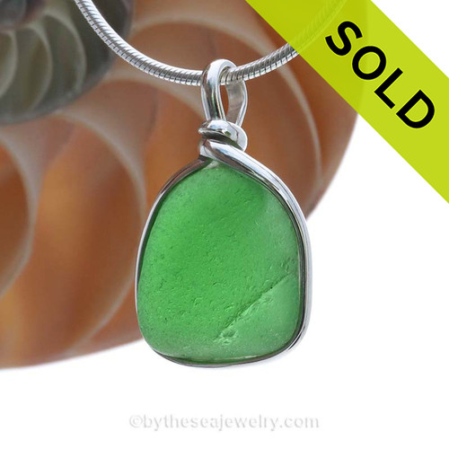 This is a mid sized crizzled Green Genuine Sea Glass Pendant in our Original Wire Bezel© setting in Solid Sterling Silver . SOLD - Sorry this Sea Glass Pendant is NO LONGER AVAILABLE!