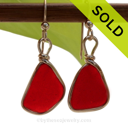 P-E-R-F-E-C-T Petite Bright Ruby Red Genuine Sea Glass in our Original Wire Bezel© earring setting lets all the color of these beautiful gold set beach found sea glass pieces shine! SOLD - Sorry these Rare Sea Glass Earrings are NO LONGER AVAILABLE!