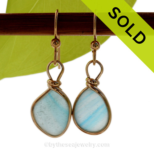 Cross Sectioned Sky Blue Ultra Rare Sea Glass Earrings set in our Original Wire Bezel© setting In 14K Goldfilled. SOLD - Sorry these Ultra Rare Sea Glass Earrings are NO LONGER AVAILABLE!
