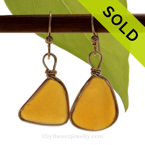 A lovely pair of long and larger VIVID Amber Brown Genuine Sea Glass Earrings in our Original Bezel Wire© setting in 14K Goldfilled. SOLD - Sorry these Sea Glass Earrings are NO LONGER AVAILABLE!