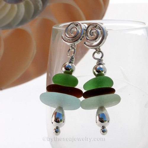 A triple stack of Seafoam, Amber and vivid green sea glass pieces with sterling details on solid sterling sea Swirl Posts
