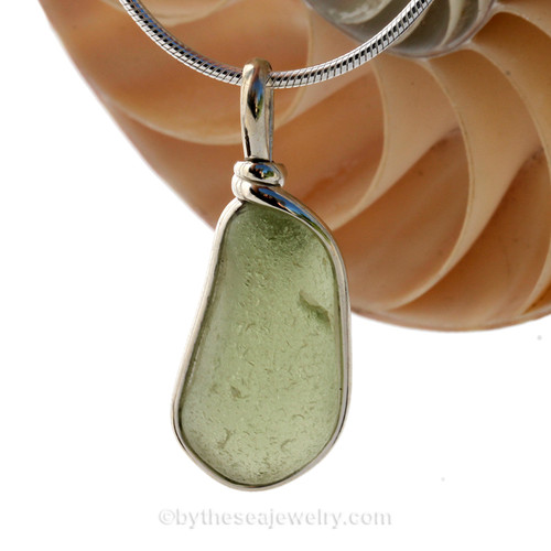 This is a P-E-R-F-E-C-T piece of Perdiot Green Sea Glass Jewelry set in our Original Wire Bezel© pendant setting in Sterling Silver .