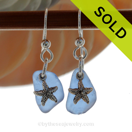 A pair of Natural Surf Tumbled Genuine Carolina Blue Sea Glass Earrings with Solid Sterling Starfish Charms. SOLD - Sorry these Rare Sea Glass Earrings are NO LONGER AVAILABLE!