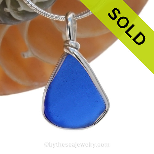 A smaller piece of Cobalt Blue Genuine Sea Glass  bottle bottom with in our signature Original Wire Bezel© pendant setting in Sterling Silver. SOLD - Sorry this Rare Sea Glass Pendant is NO LONGER AVAILABLE!