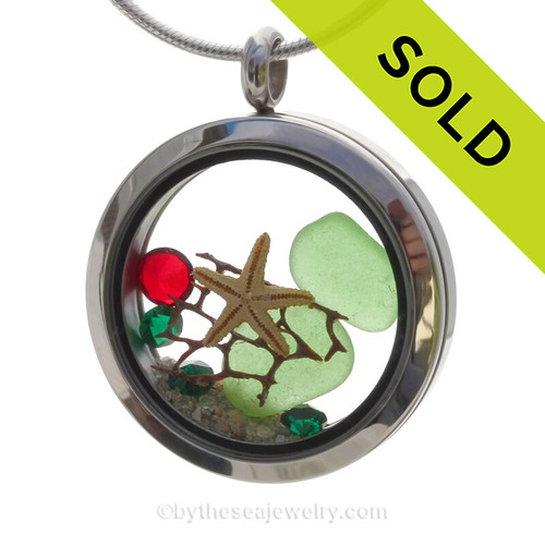 Green sea glass and a real starfish and beach make this a great locket necklace for the holidays. Ruby Red  & Emerald Green crystal gems finish the locket with some extra bling.