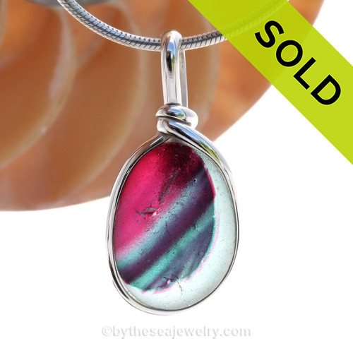 A vivid mix of hot pink and subtle blue and teal with streaks  of purple in this in a base of pure white endoday sea glass from England set in our Original Wire Bezel© necklace pendant setting. SOLD - Sorry this Sea Glass Jewelry Selection is NO LONGER AVAILABLE!