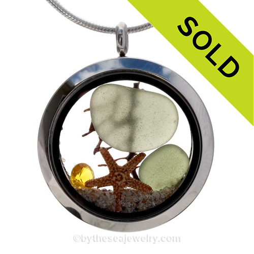 Seaweed Green sea glass pieces combined with a real starfish and crystal topaz gem for November stainless steel locket.