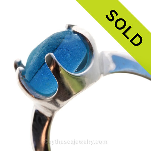 A stunning piece of Victorian Era vivid Electric Aqua sea glass set in a secure solid sterling prong ring. SOLD - Sorry this Sea Glass Jewelry selection is NO LONGER AVAILABLE!