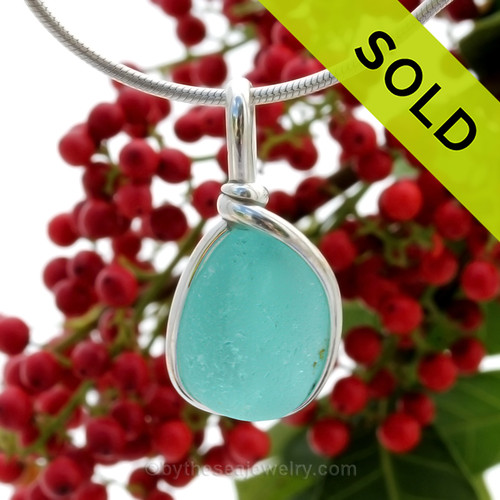 This is a beautiful Aqua Blue Sea Glass set in our Original Wire Bezel© pendant setting in Sterling Silver . Nice flatter piece with an extra large bail. SOLD - Sorry this Rare Sea Glass Pendant is NO LONGER AVAILABLE!