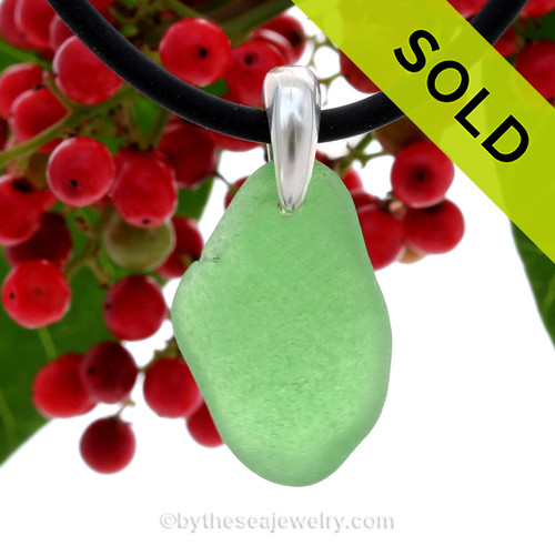 A nice piece of green sea glass from the OBX set  on a Sterling bail with Black Neoprene Cord. SOLD - Sorry this Sea Glass Necklace is NO LONGER AVAILABLE!