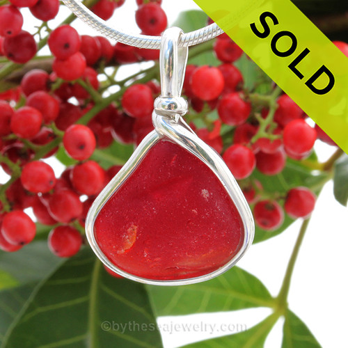 Stunning and Perfect reddish orange sea glass is set in our Original Wire Bezel© pendant setting.