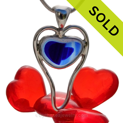 A beautiful small and rare Mixed Blue Multi color natural sea glass heart set in our deluxe wire bezel pendant setting!  Genuine sea glass hearts are a RARE phenomena and cherished among sea glass lovers! SOLD - Sorry this Rare Sea Glass Pendant is NO LONGER AVAILABLE!