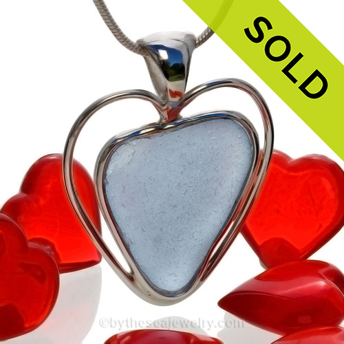 A beautiful and Ultra Rare Ice Blue natural sea glass heart set in our deluxe wire bezel pendant setting!  Genuine sea glass hearts are a RARE phenomena and cherished among sea glass lovers! SOLD - Sorry this Rare Sea Glass Pendant is NO LONGER AVAILABLE!