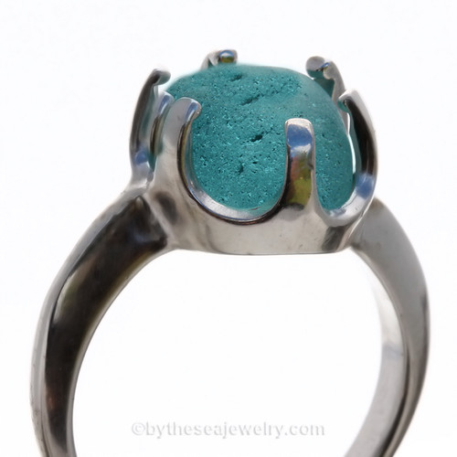 A stunning piece of Victorian Era vivid Electric Aqua sea glass set in a secure solid sterling prong ring.