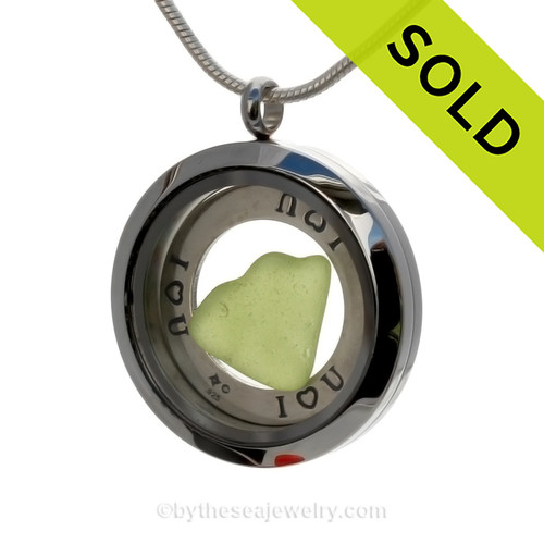 Genuine lime green heart shaped sea glass combined and a Solid Sterling i ♥ U circle charm, in this stainless steel locket. SOLD - Sorry this Sea Glass Locket is NO LONGER AVAILABLE!