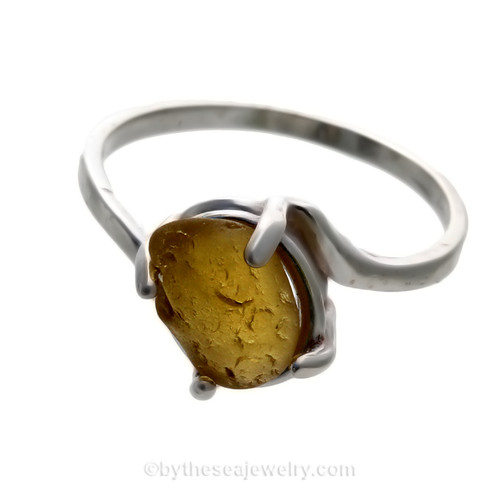 A stunning simple Golden Yellow sea glass ring perfect for any sea glass lover!