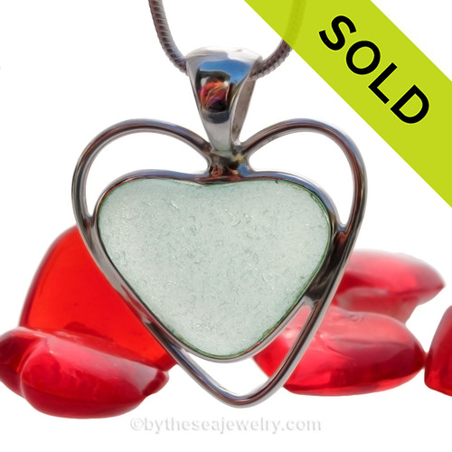 A beautiful and mid rare Seafoam Green  natural sea glass heart set in our deluxe wire bezel pendant setting!  Genuine sea glass hearts are a RARE phenomena and cherished among sea glass lovers! SOLD - Sorry this Sea Glass Necklace is NO LONGER AVAILABLE!