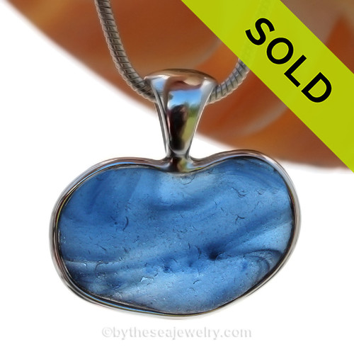 A beautiful small and rare Mixed Blue Multi color natural sea glass heart set in our deluxe wire bezel pendant setting!  Genuine sea glass hearts are a RARE phenomena and cherished among sea glass lovers