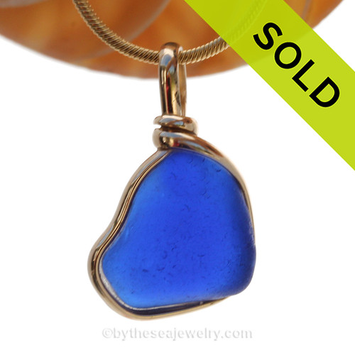 This is a beautiful thick piece of sea glass where one side is thicker than another. Looks to have been the bottom of an old blue jar, maybe Noxzema. SOLD - Sorry this Rare Sea Glass Pendant is NO LONGER AVAILABLE