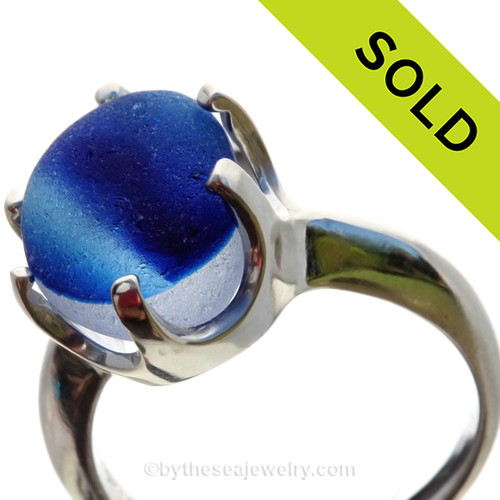 A stunning piece of Victorian Era vivid Mixed Blue sea glass set in a secure solid sterling prong ring.