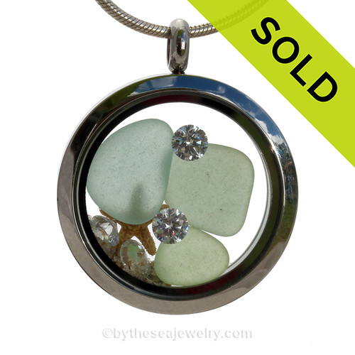Beautiful pure Seafoam Green  sea glass combined in a stainless steel locket necklace with a real starfish and 4 crystal gems (diamonds). Finished with real beach sand.  SOLD - Sorry this Sea Glass Locket Necklace is NO LONGER AVAILABLE!!!