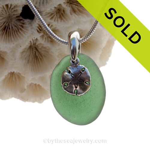 Deep Leaf Green Sea Glass Necklace With Sterling Silver Sandollar Charm.