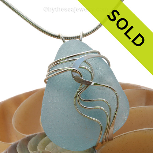 A stunning and LARGE Genuine Electric Aqua Sea Glass Pendant set in our Signature Waves© setting in Sterling Silver.