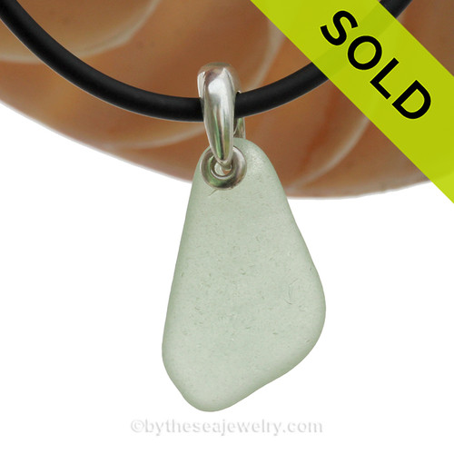 A nice piece of Sea Green Natural Sea Glass Necklace Set On Silver Bail With Black Neoprene Cord with sterling clasps