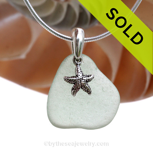 """Petite Seafoam Green sea glass set on a solid sterling cast bail with a sterling silver Starfish charm. The sea glass necklace comes on our 18"""" solid sterling smooth snake chain (SHOWN and included)"""