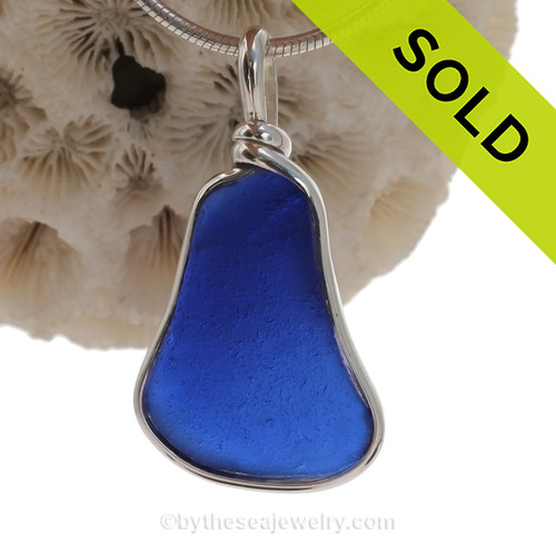 A VIVID Cobalt Blue Thick and Squarish genuine Sea Glass pieces set in our Original Deluxe Wire Bezel© necklace pendant.