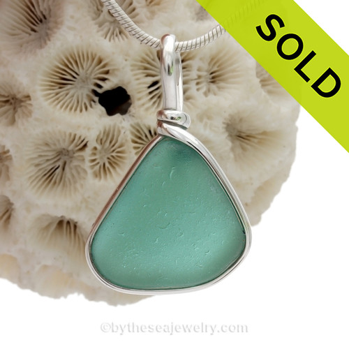 Genuine Beach found Teal Green Sea Glass in our Original Wire Bezel© pendant setting in solid sterling silver.