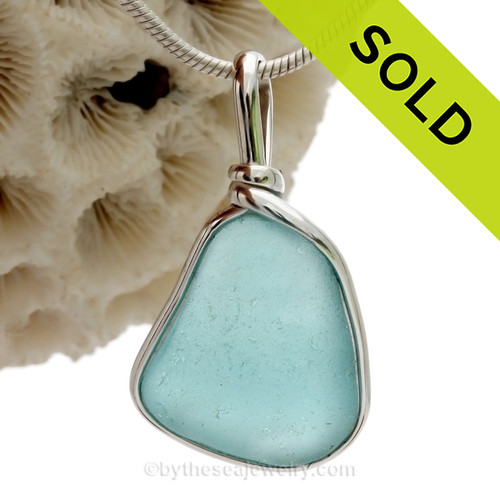 Genuine Beach found Turquoise Sea Glass in our Original Wire Bezel© pendant setting in solid sterling silver.