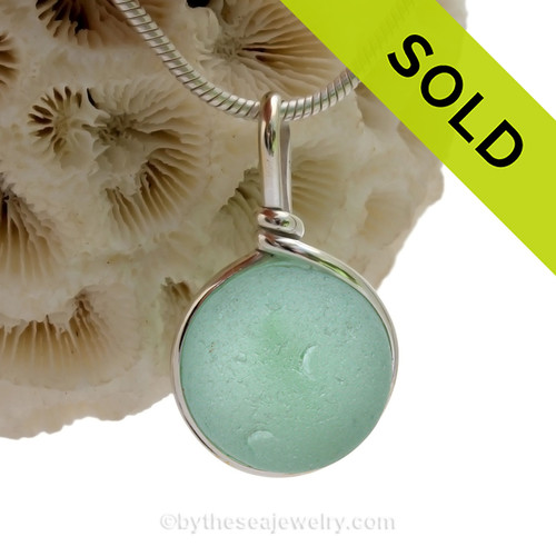 A Genuine Beach Found Seawater Green Sea Glass Marble set in our Deluxe Solid Sterling Deluxe Bezel setting.
