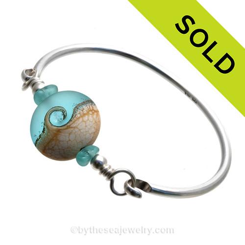 VIVID Aqua and Aqua Green Genuine Sea Glass Bangle Bracelet set with a handmade lampwork glass Wave bead set with Sterling Details on a Solid Sterling Round Bangle Bracelet.