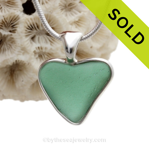 A small natural  green sea glass heart set in our Deluxe Wire Bezel© A great necklace for any time of year and perfect for any sea glass lover!