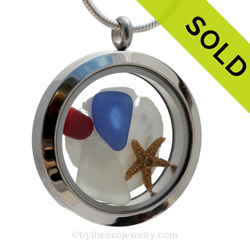 Cobalt Blue and a small piece of Ruby Red Sea Glass in a crystal and stainless steel locket combined with a baby starfish, sandollar.   SOLD - Sorry this Sea Glass Jewelry selection is NO LONGER AVAILABLE!