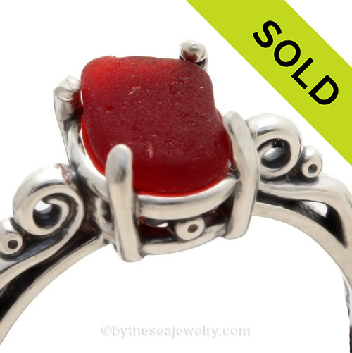 A stunning and lovely piece of bright Rare Ruby Red NATURAL beach found sea glass securely set in a solid sterling silver scroll ring.  Ruby red glass is made mostly by the Anchor Hocking Company and was used widely in the mid 20th century in products like Schlitz Beer (show here), Avon products and houseware items. SOLD - Sorry this Sea Glass Jewelry selection is NO LONGER AVAILABLE!
