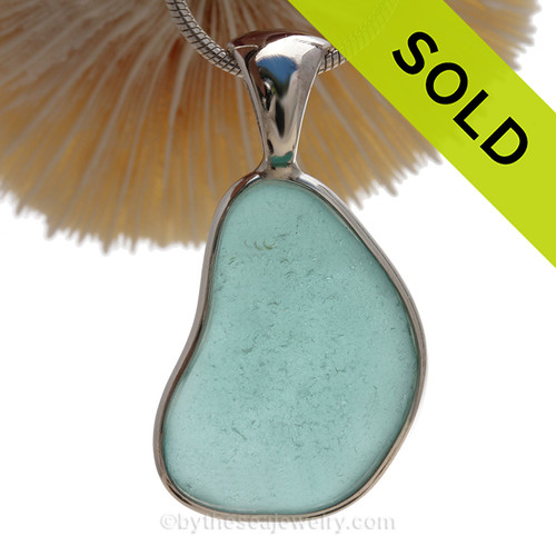 A QUALITY RARE Aqua Blue Genuine Sea Glass Pendant set in our Signature Deluxe Wire Bezel setting in Sterling Silver.