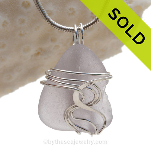 """A beautiful natural lavender sea glass jewelry set in our original signature """"Waves"""" setting in solid sterling silver."""