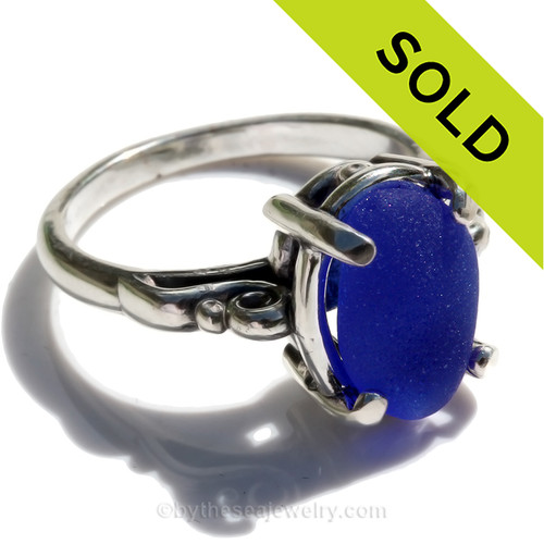 A stunning beautiful piece of vivid cobalt blue sea glass from set in a silver ring.