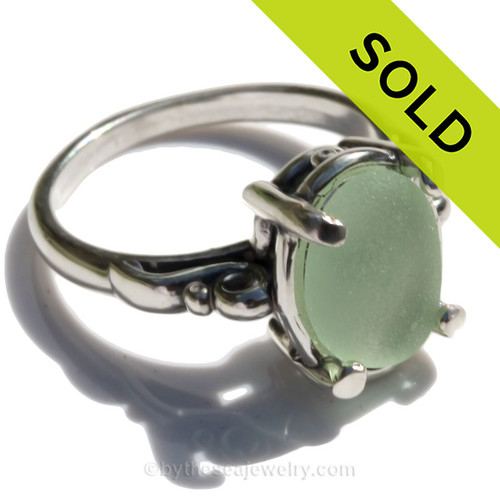 A stunning and lovely piece of NATURAL beach found Fresh Seafoam Green sea glass securely set in a solid sterling silver scroll ring.  Seafoam sea glass is considered mid rare and is becoming increasingly hard to find as each tide passes. This amazing vivid sea glass piece hails from Puerto Rico and is UNALTERED from  the way it was found on the beach.