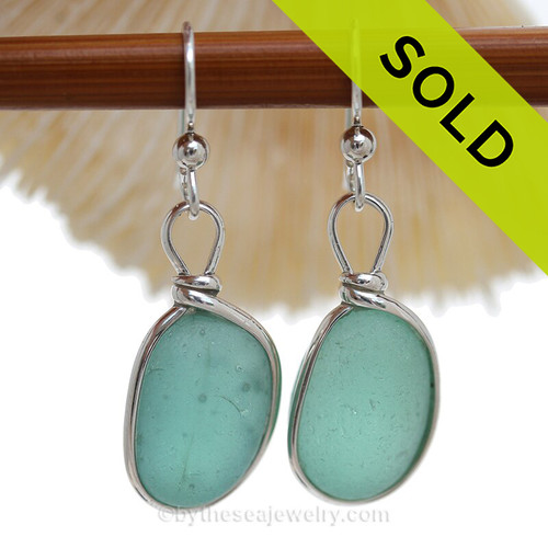 Round and Thick pieces of natural Deep Aqua Green sea glass set in our Original Wire Bezel© earring setting. Unaltered genuine sea glass from Seaham England and the site of former glass factories that discarded glass into local waters.
